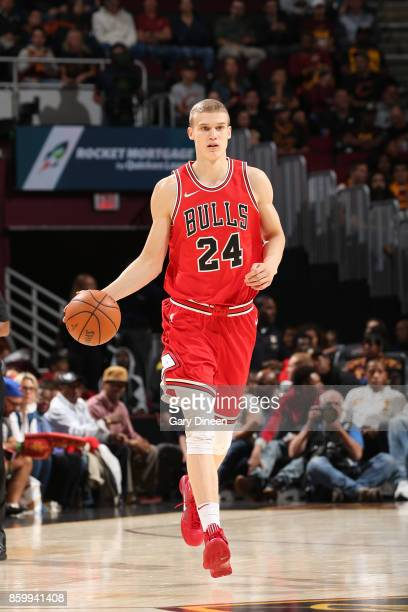 Lauri Markkanen of the Chicago Bulls handles the ball against the Cleveland Cavaliers during a preseason game on October 10 2017 at Quicken Loans...