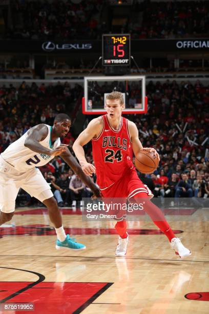 Lauri Markkanen of the Chicago Bulls handles the ball against the Charlotte Hornets on November 17 2017 at the United Center in Chicago Illinois NOTE...
