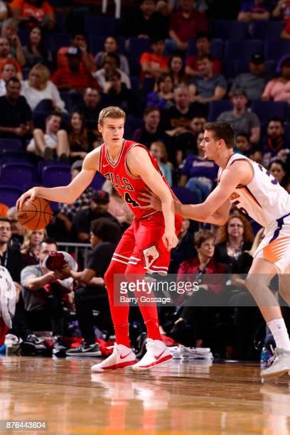 Lauri Markkanen of the Chicago Bulls handles the ball against the Phoenix Suns on November 19 2017 at Talking Stick Resort Arena in Phoenix Arizona...