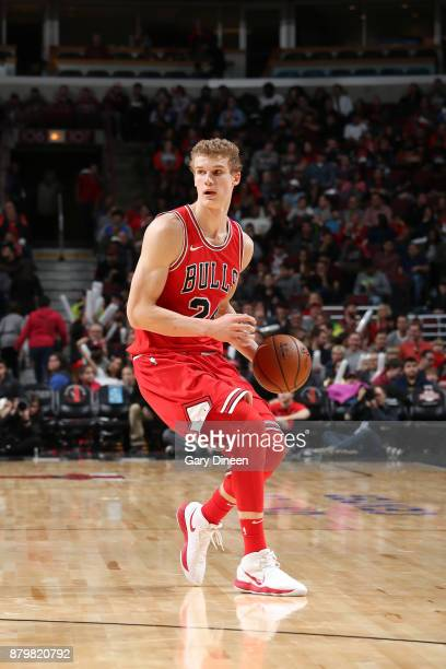 Lauri Markkanen of the Chicago Bulls handles the ball against the Miami Heat on November 26 2017 at the United Center in Chicago Illinois NOTE TO...