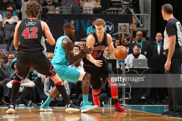 Lauri Markkanen of the Chicago Bulls handles the ball against the Charlotte Hornets on December 8 2017 at Spectrum Center in Charlotte North Carolina...
