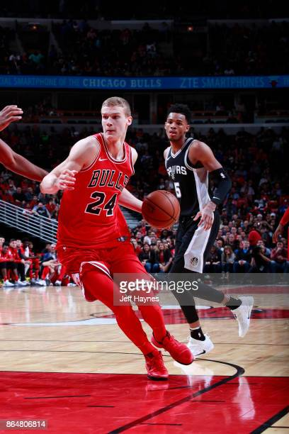 Lauri Markkanen of the Chicago Bulls handles the ball during the game against the San Antonio Spurs on October 21 2017 at the United Center in...