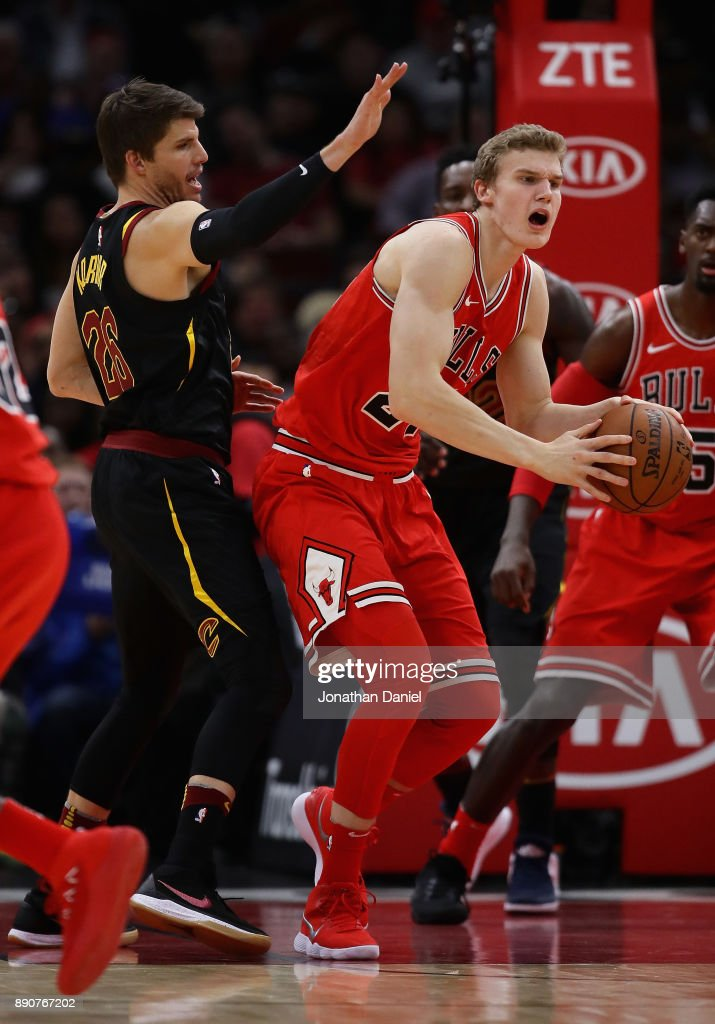 Lauri Markkanen #24 of the Chicago Bulls is pressured by Kyle Korver #26 of the Cleveland Cavaliers at the United Center on December 4, 2017 in Chicago, Illinois. The Cavaliers defeated the Bulls 113-91.