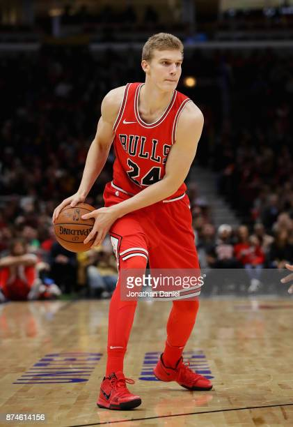 Lauri Markkanen of the Chicago Bulls looks to pass against the Indiana Pacers at the United Center on November 10 2017 in Chicago Illinois The Pacers...