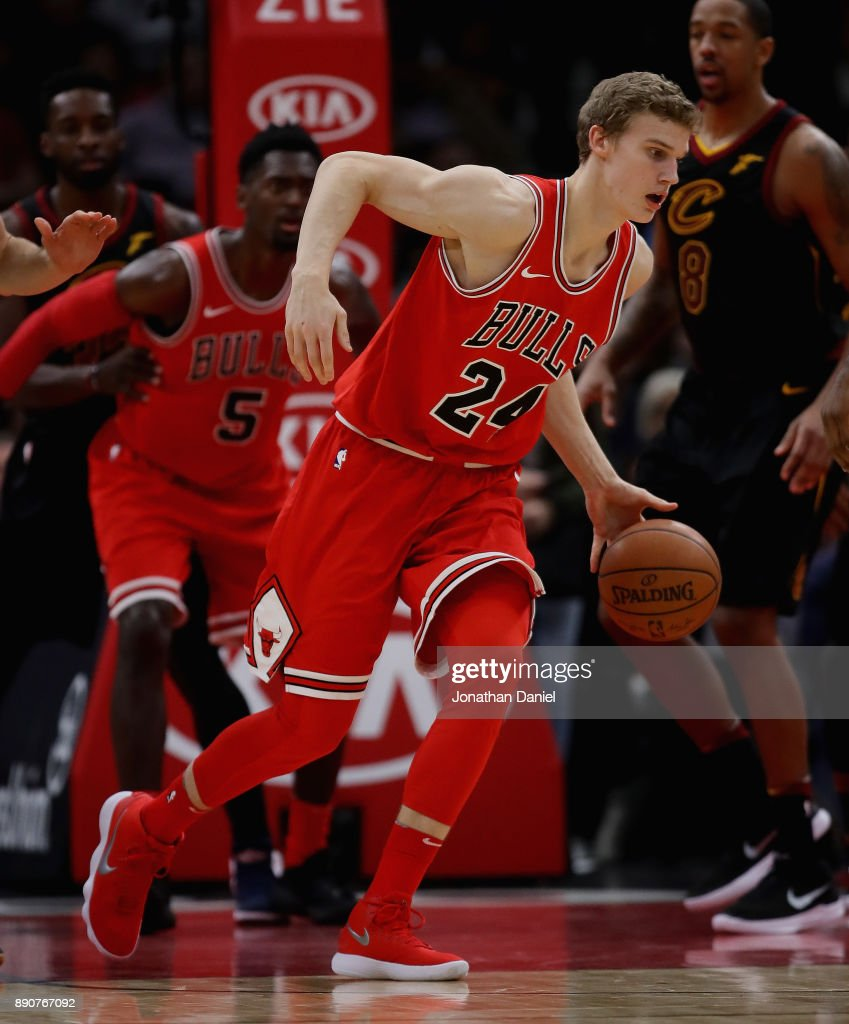 Lauri Markkanen #24 of the Chicago Bulls moves against the Cleveland Cavaliers at the United Center on December 4, 2017 in Chicago, Illinois. The Cavaliers defeated the Bulls 113-91.