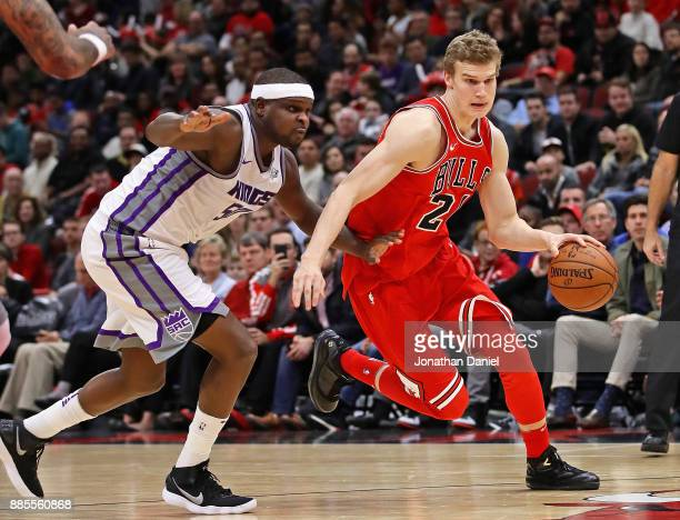 Lauri Markkanen of the Chicago Bulls moves past Zach Randolph of the Sacramento Kings at the United Center on December 1 2017 in Chicago Illinois The...