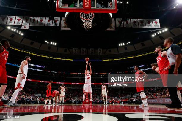 Lauri Markkanen of the Chicago Bulls shoots a free throw against the Toronto Raptors on October 13 2017 at the United Center in Chicago Illinois NOTE...