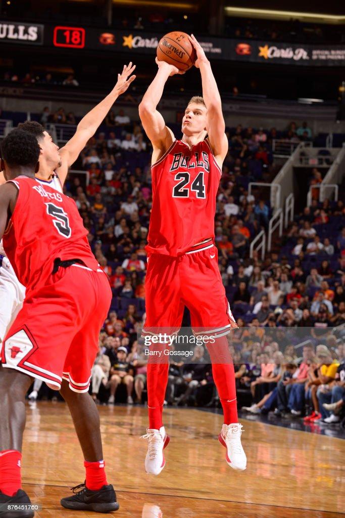 Lauri Markkanen #24 of the Chicago Bulls shoots the ball against the Phoenix Suns on November 19, 2017 at Talking Stick Resort Arena in Phoenix, Arizona.