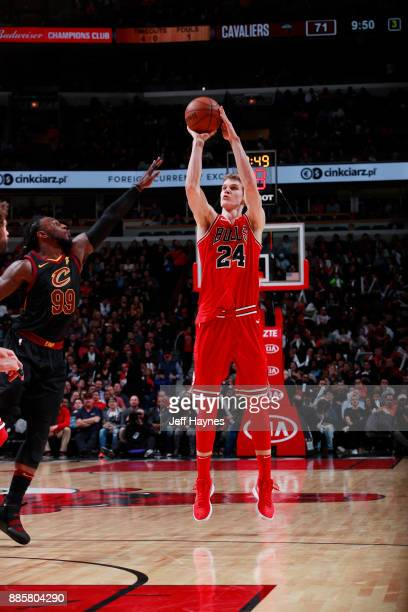 Lauri Markkanen of the Chicago Bulls shoots the ball against the Cleveland Cavaliers on December 4 2017 at the United Center in Chicago Illinois NOTE...
