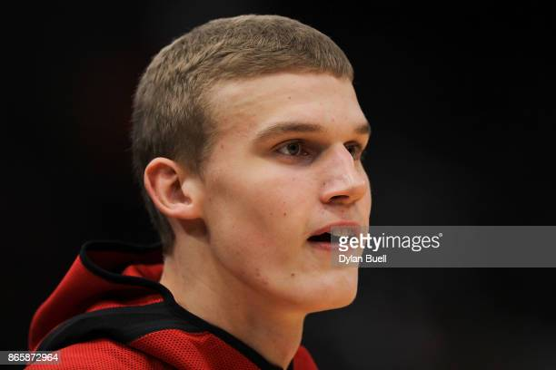 Lauri Markkanen of the Chicago Bulls warms up before the game against the San Antonio Spurs at the United Center on October 21 2017 in Chicago...