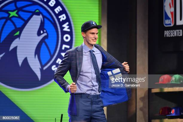 Lauri Markkanen shows off his jacket after being selected seventh overall by the Minnesota Timberwolves at the 2017 NBA Draft on June 22 2017 at...