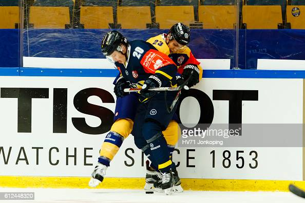 Lauri Tukonen of Lukko Rauma battling for the puck with Lawrence Pilut of HV71 Jonkoping during the Champions Hockey League Round of 32 match between...