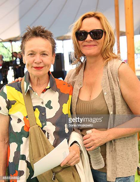 Laurie Anderson and Kim Cattrall attend the Perfect Earth Project Family Picnic and Concert on August 30 2014 in East Hampton New York