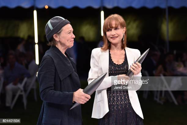 Laurie Anderson Isabelle Huppert attend The 24th Annual Watermill Center Summer Benefit Auction at The Watermill Center on July 29 2017 in Water Mill...