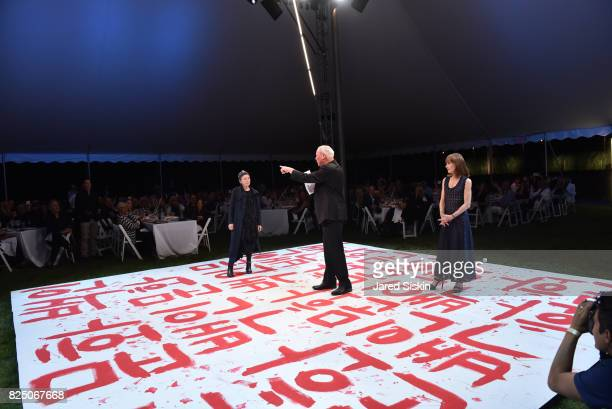 Laurie Anderson Robert WIlson and Isabelle Huppert attend The 24th Annual Watermill Center Summer Benefit Auction at The Watermill Center on July 29...