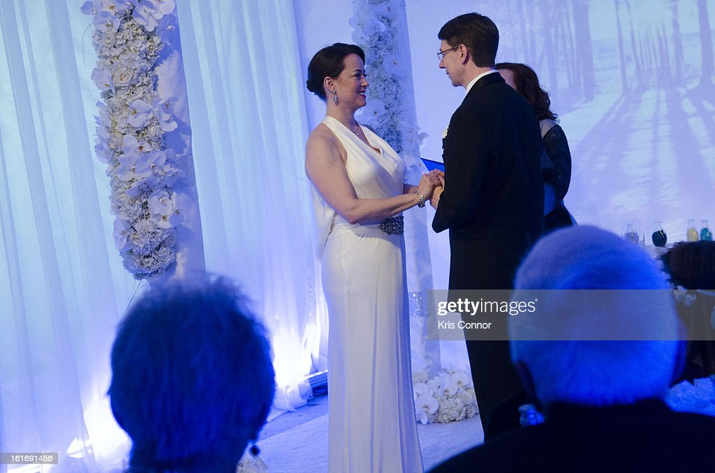 Laurie Ann Phillips and Daniel Rosenthal of Washington DC are married during the Empire State Building Hosts Valentine's Day Weddings cereomy at The Empire State Building on February 14, 2013 in New York City.