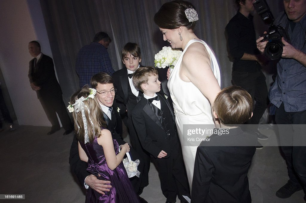 Laurie Ann Phillips and Daniel Rosenthal of Washington DC greet their children after being wed during the Empire State Building Hosts Valentine's Day Weddings ceremony at The Empire State Building on February 14, 2013 in New York City.