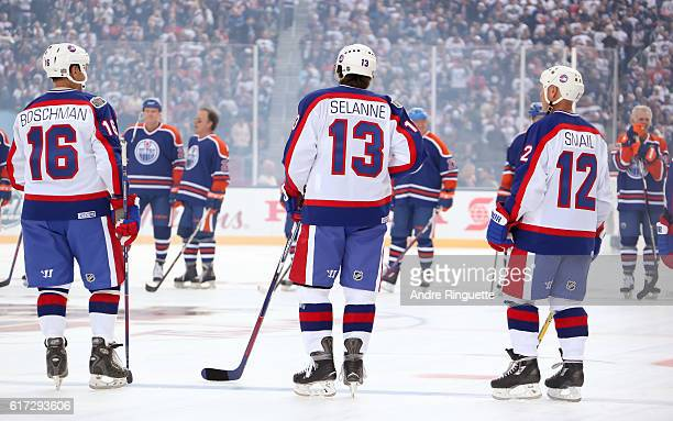 Laurie Boschman Teemu Selanne and Doug Smail of the Winnipeg Jets alumni line up during the 2016 Tim Hortons NHL Heritage Classic alumni game at...