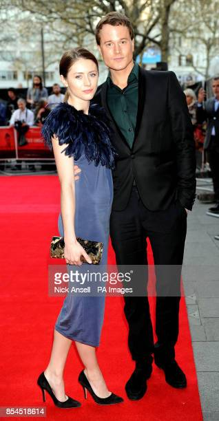 Laurie Calvert and his partner Sophie Dunnage arrive for the premiere of The Quiet Ones at the Odeon West End Leicester Square London