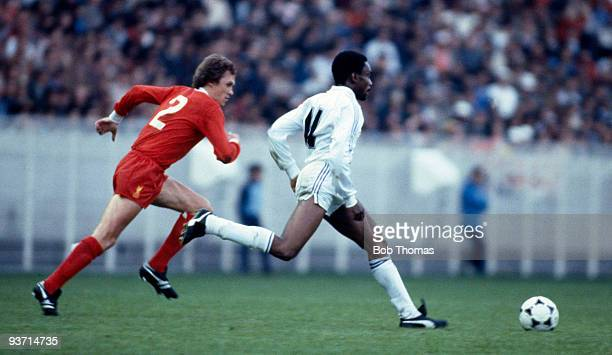 Laurie Cunningham of Real Madrid is chased by Phil Neal of Liverpool during their European Cup final match held at the Parc des Princes in Paris 27th...