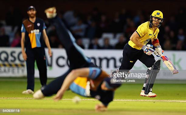 Laurie Evans of Warwickshire hits the ball towards the boundary during the NatWest T20 Blast match between Derbyshire and Warwickshire at The 3aaa...
