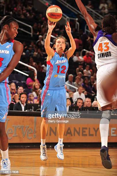 Laurie Koehn of the Atlanta Dream shoots against Nakia Sanford of the Phoenix Mercury on July 07 2012 at US Airways Center in Phoenix Arizona NOTE TO...