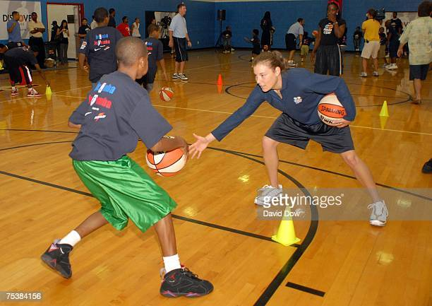 Laurie Koehn of the Washington Mystics instructs a young kid during the WNBA AllStar Basketball Clinic presented by Discover Card on July 12 2007 at...