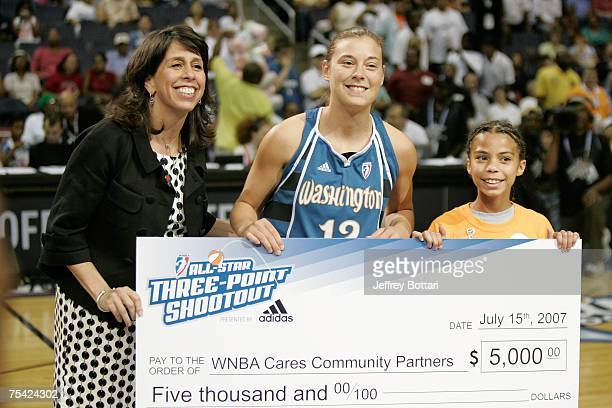 Laurie Koehn of the Washington Mystics is presented a check by WNBA President Donna Orender after she won the 3 Point Shootout prior to the 2007 WNBA...