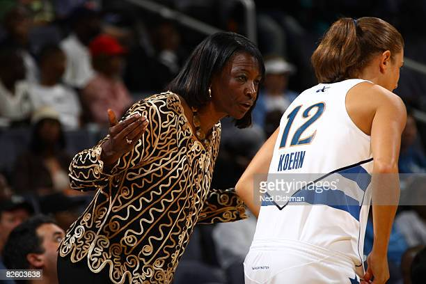 Laurie Koehn of the Washington Mystics speaks with Head Coach Jessie Kenlaw during game against the Chicago Sky at the Verizon Center on August 29...