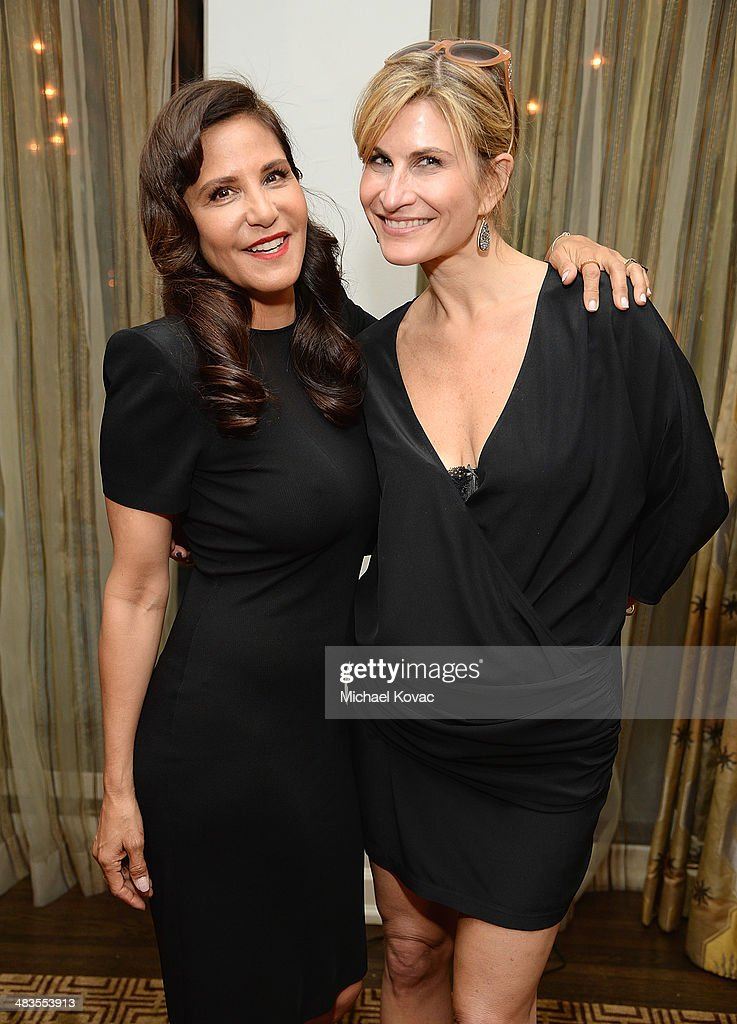Laurie Stark (L) and Lauren Kucerak attend Kate Hudson celebrates the Little Black Dress Collection for Ann Taylor at Chateau Marmont on April 8, 2014 in Los Angeles, California.