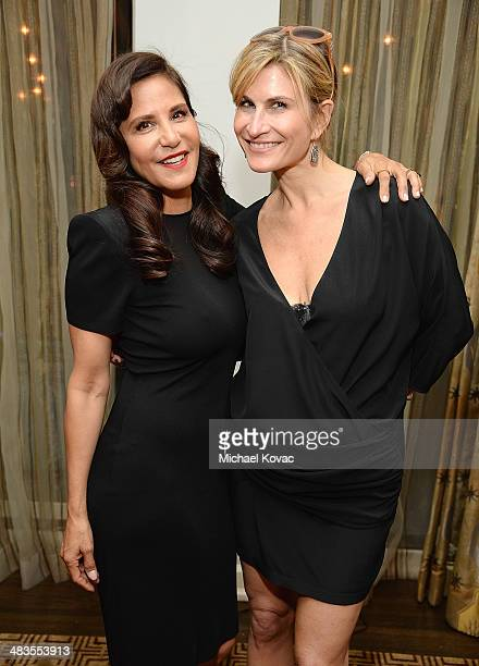 Laurie Stark and Lauren Kucerak attend Kate Hudson celebrates the Little Black Dress Collection for Ann Taylor at Chateau Marmont on April 8 2014 in...