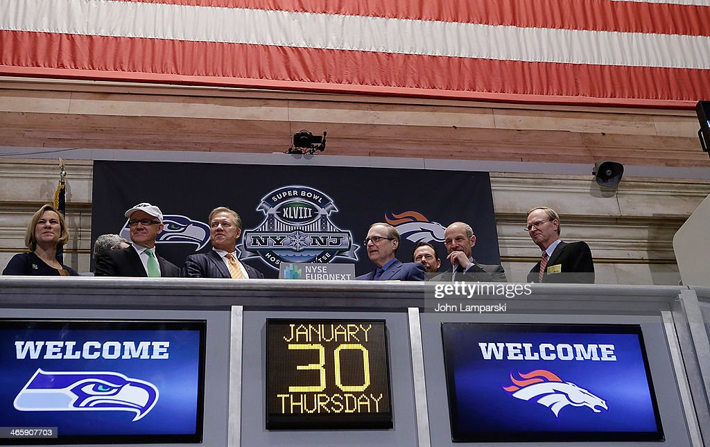 Laurie Tisch, Co Owner of the NY Jets Woody Johnson, Executive VP of Football Operations Denver Broncos, John Elway, Owner of the Seattle Seahawks Paul Allen Co- owner of the NY Giants John Tisch and Co-owner of the NY Giants John Mara ring the opening bell at New York Stock Exchange on January 30, 2014 in New York City.