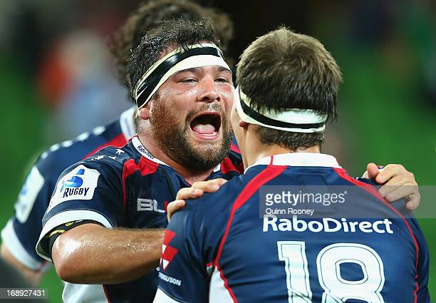 Laurie Weeks and Luke Jones of the Rebels celebrate winning the round 14 Super Rugby match between the Rebels and the Stormers at AAMI Park on May 17...