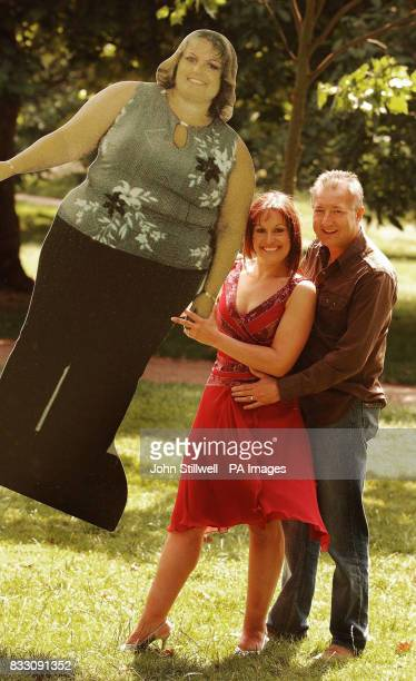Laurie Wells aged 35 from Worcester holds a picture of her former self with husband Geoff as she shows off her new slimmer figure after losing just...