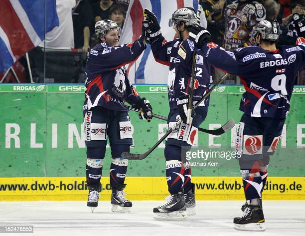 Laurin Braun of Berlin jubilates with team mates after scoring the first goal during the DEL match between EHC Eisbaeren Berlin and Duesseldorfer EG...