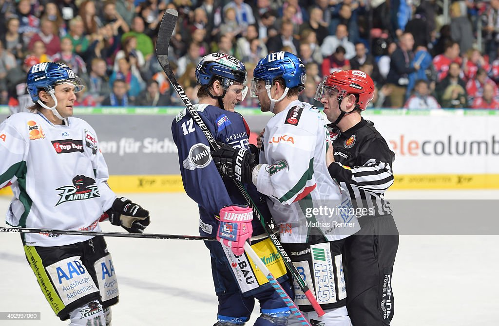 Laurin Braun of the Eisbaeren Berlin and Adrian Grygiel of the Augsburger Panther kaempfen during the game between the Eisbaeren Berlin and Augsburger Panther on October 16, 2015 in Berlin, Germany.