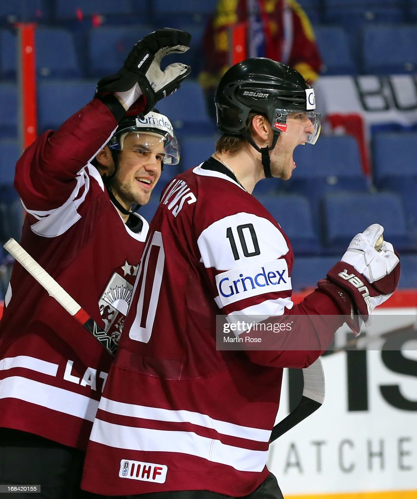 Lauris Darzins (#10) of Latvia celebrate with team mate Krisjanis Redlihs (L) after he scores his team's 5th goal during the IIHF World Championship group H match between Russia and France at Hartwall Areena on May 9, 2013 in Helsinki, Finland.