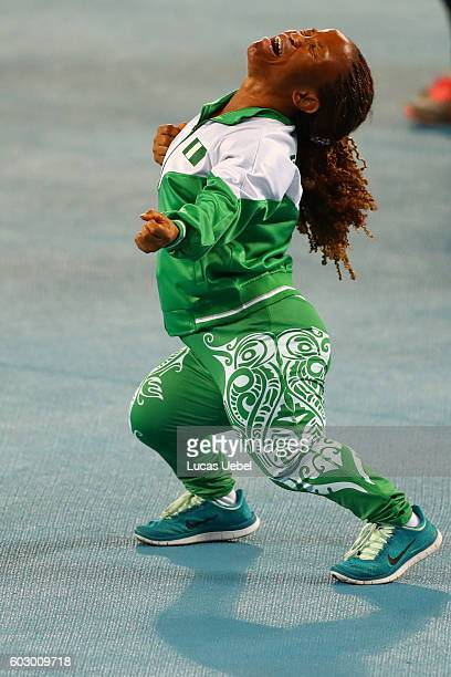 Lauritta Onye of Nigeria celebrates after break the world record in the Women's Shotput Final on day 4 of the Rio 2016 Paralympic Games at Olympic...