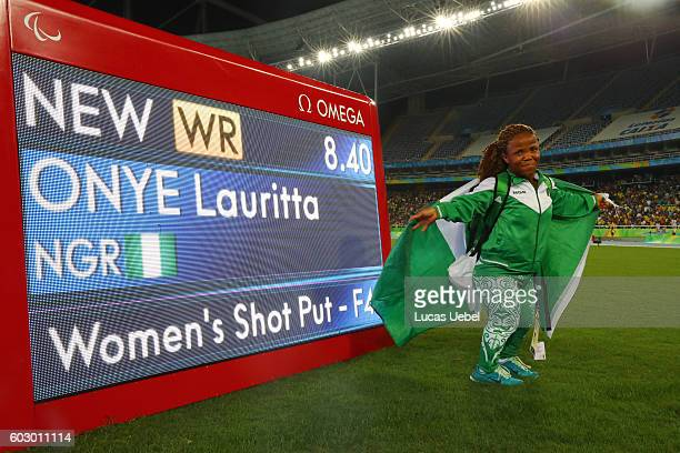 Lauritta Onye of Nigeria poses after breaking the world record in the Women's Shotput Final on day 4 of the Rio 2016 Paralympic Games at Olympic...