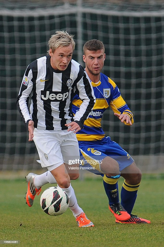 Laursen (L) of Juventus FC in action against Petrini of FC Parma during the Juvenile match between Juventus FC and FC Parma at Juventus Center Vinovo on November 21, 2012 in Vinovo, Italy.
