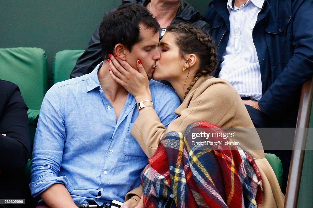 Laury Thilleman and her companion Juan Arbelaez attend the French Tennis Open Day 8 at Roland Garros on May 29, 2016 in Paris, France.