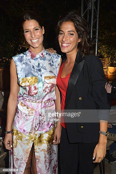 Laury Thilleman and Laurie Cholewa attend the show 'The Art Of Illusion' at Palais De Tokyo on September 24 2014 in Paris France