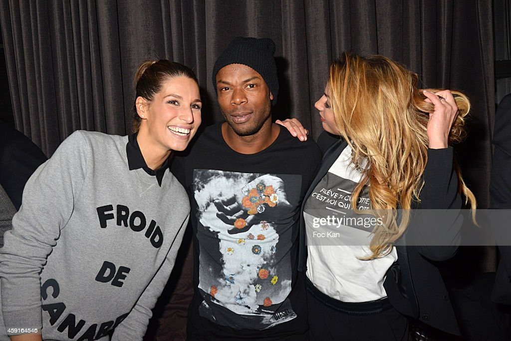 Laury Thilleman, Sylvain Wiltord and Ariane Brodier attend Saperlipopette' : Norbert Cremaillere Party on November 17, 2014 in Puteaux, France.