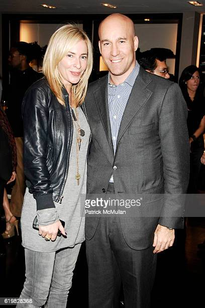 Lauryn Flynn and Marc Berger attend Burberry and Men's Vogue Celebrate the Launch of Estate 1127 by Peter Saville at Burberry on October 1 2008 in...