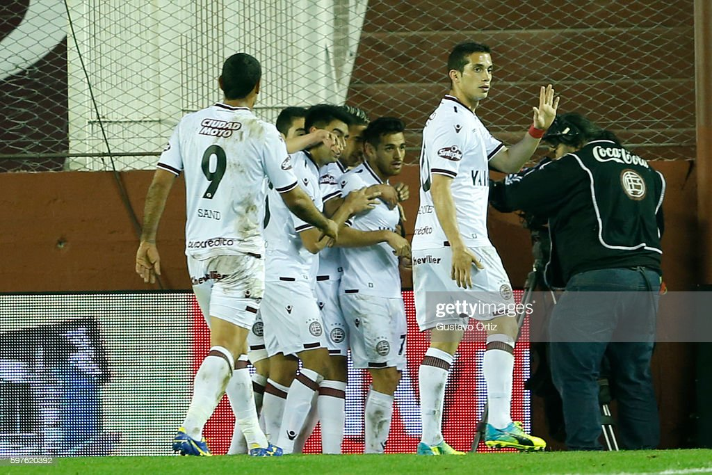 Lautaro Acosta of Lanus celebrates with teammates after scoring the first goal of his team during a match between Lanus and Boca Juniors as part of...