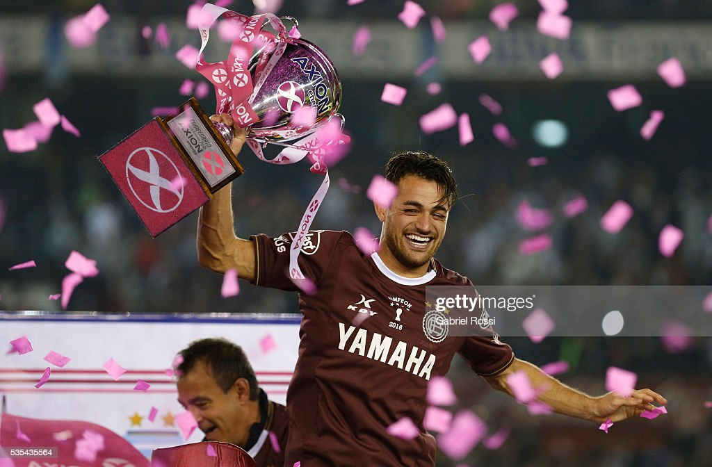Lautaro Acosta of Lanus celebrates with the trophy after a final match between San Lorenzo and Lanus as part of Torneo Transicion 2016 at Monumental Stadium on May 29, 2016 in Buenos Aires, Argentina.