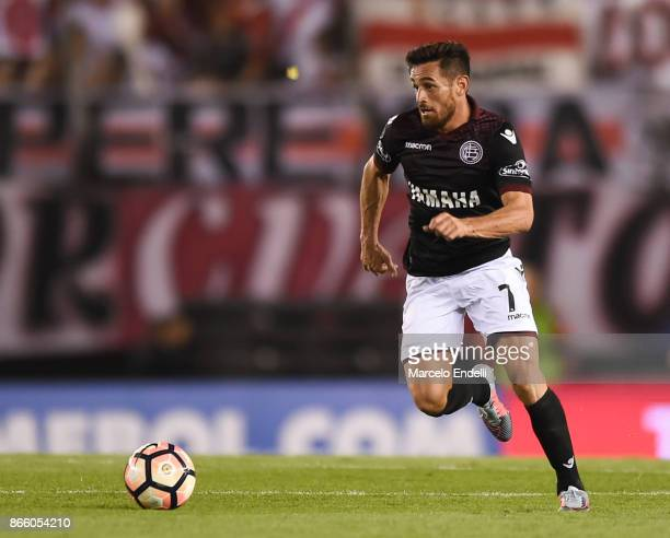 Lautaro Acosta of Lanus drives the ball during a first leg match between River Plate and Lanus as part of semifinals of Copa CONMEBOL Libertadores...