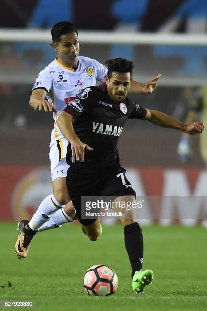 Lautaro Acosta of Lanus fights for ball with Pablo Escobar of The Strongest during the second leg match between Lanus and The Strongest as part of...