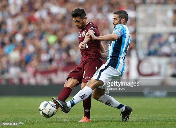Lautaro Acosta of Lanus fights for the ball with Lisandro Lopez of Racing Club during a match between Racing Club and Lanus as part of Copa del...