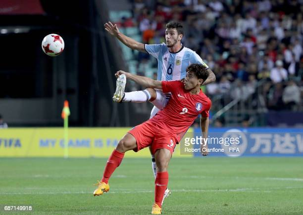 Lautaro Martinez of Argentina and Lee Seungmo of Korea Republic compete for the ball during the FIFA U20 World Cup Korea Republic 2017 group A match...